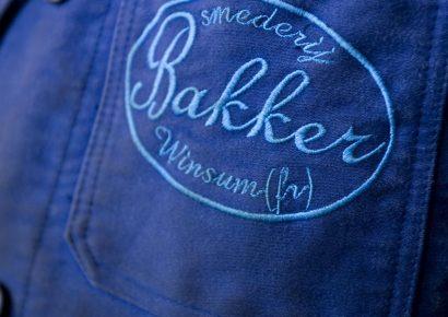 Overall, logo: Smederij Bakker Winsum 1948